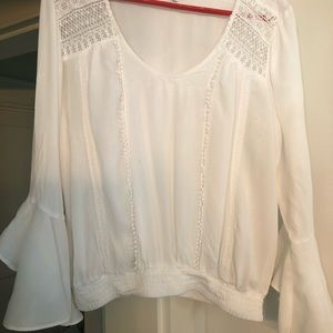 Express top with ruffled sleeve